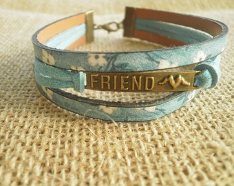 "Bracelet made of suede and faux leather, turquoise and white colors and ""friend"" charm"