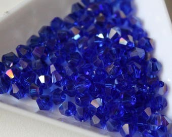 x 10 #T02 faceted bicone beads - iridescent - blue azure - 4mm - Crystal from Austria