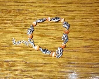 Bracelet foliage and orange cat eye beads