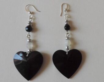 Black heart on white resin bead earrings