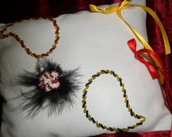 Pillow wedding ring pillow with drops of water pearls and ribbons