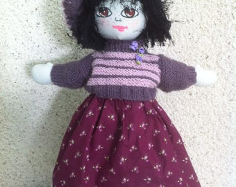 Doll realized completely in the hand