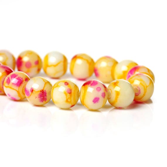 Set of 5 glass beads - yellow and pink - 8 mm