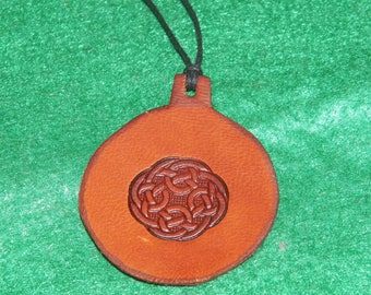 Leather with a round Celtic design pendant