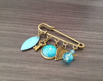 Navette Turquoise Cabochon brooch.