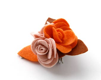 Brooch with rose-pink and orange felt and cloth
