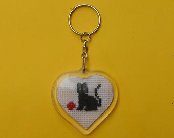 Heart shaped key chain with a cat