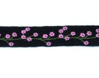 Fancy flowers with black twill tape