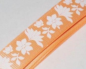 1 meter Ribbon coarse white flowers, neon orange background