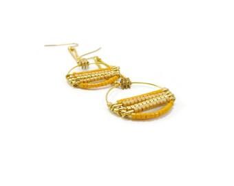 Yellow long hoop earrings on ball chain