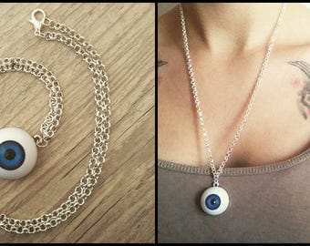 Silver necklace adorned with a blue eye.
