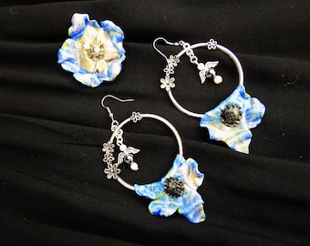 """Dramatic earrings * soft flowers"""