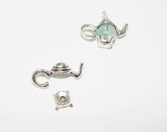 Teapot shaped, silver pendant charm.