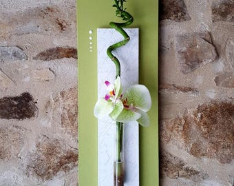 Green and white floral table with twisted lucky bamboo