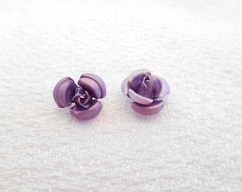 2 purple flower shaped metal beads.