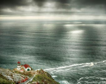 Point Reyes Lighthouse With God Rays Glowing On The Water
