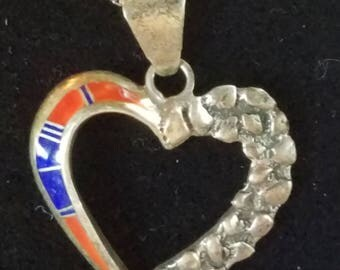 Heart shape pendant with Blue and Orange stones on the left side with chain about 31 inches lonh