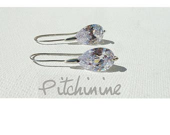 Sterling Silver and white gold adorned with a white Swarovski PEAR Crystal