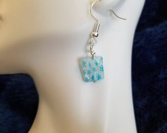 Clear with blue flowers dangle earrings
