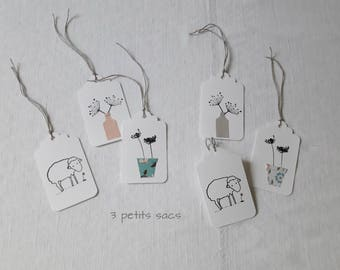 6 sheep, grass and thick white paper tags