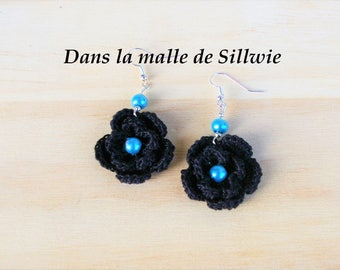 pair of black and blue earrings