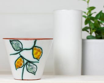 Ceramic flower pot decorated with leaves