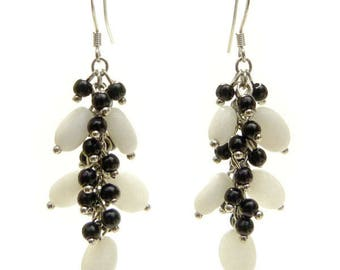 Earrings dangle delicate little cluster stones black and white round and oval