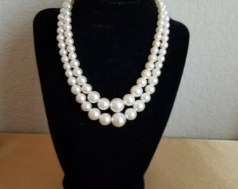 "Double strand white pearl necklace, graduated pearls, hook closure.  7"" with a 3"" extention."