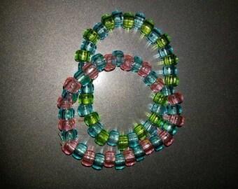 Pink and green kandi bracelets