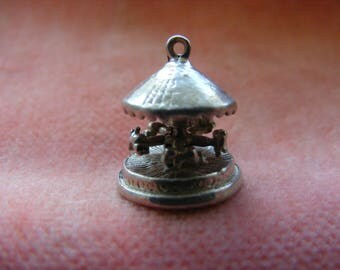 B) Rare Vintage Sterling Silver Charm Merry-go-round moves