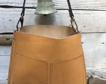 Brown tote handbag out of natural leather with snap hooks