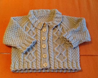 Babies knitted jacket.