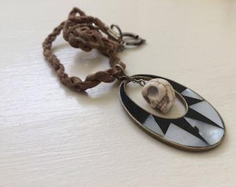 Skull pendant on buckskin cord / skull necklace / geometric / black and white / ceramic skull / macabre / folk punk / gothic / leather