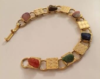 Gold tone bracelet with coloured stones