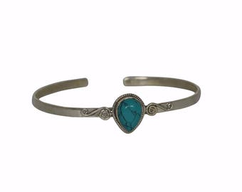 Sterling silver bracelet with turquoise bead