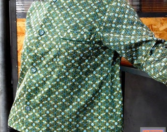 Tunic with gold, blue pattern on green background