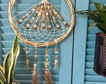 Gold dream catcher with triangular web and beading
