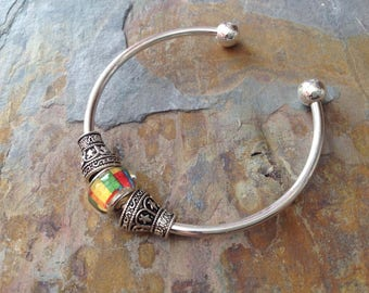 Silver bangle with bead