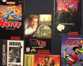 Nintendo and Sega Video Game Manuals Instruction Booklets for N64 , SNES , Sega Genesis