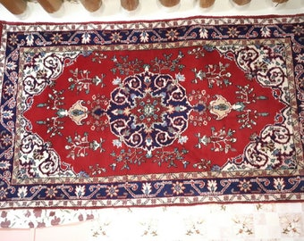 Four 60x100 inches, 100+ year-old rugs