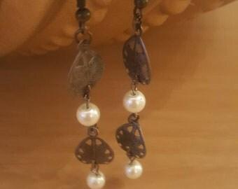 Pearl and leaf dangle earrings