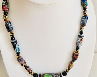 Dark multi colored necklace .
