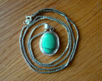 Silver Pendant with natural Turquoise.