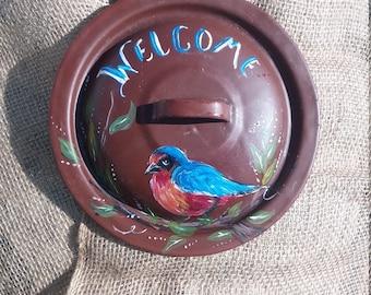 Welcome blue bird on tin lid