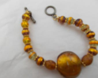 Bracelet with lamp work beads and gold plate metal