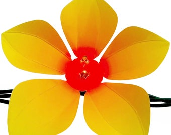 Decorative yellow die-cut flowers for string lights