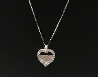 Vintage sterling silver heart pendant with clear rhinestones