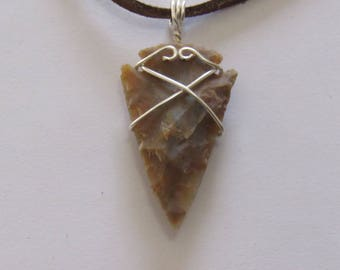 "Wire Wrapped Arrow Head on a Leather Cord, 1 3/4"" in length & 7/8"" in width."