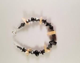 Black jade, pearl shell and hematite 6 inch bracelet.