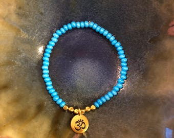 Blue and Gold OM Charm Stretch Bracelet